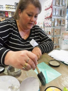 Vicki demonstrating Dylusions paints Papercraft Treasures